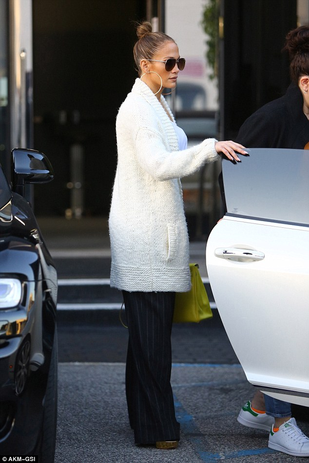 What a lady! JLo held open the door for one of her shopping pals